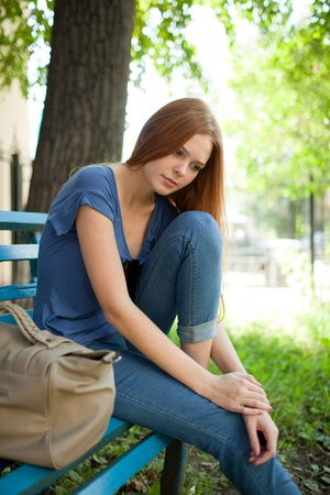 girl sitting on a bench photo