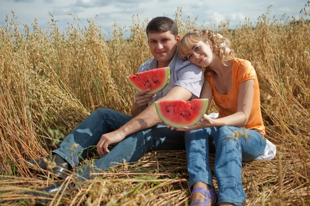 people eat watermelon and enjoy photo