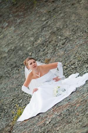 Bride sitting on the street photo