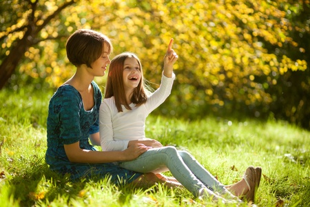 two sisters fall in the park merry together photo