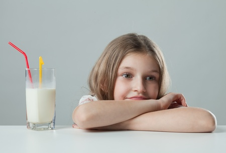 little girl with milkshake thought