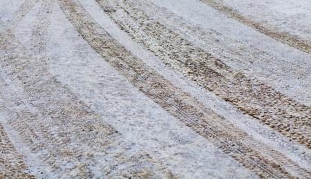 Wheel tread marks in the snow Stock Photo - 10800616