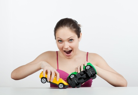 Girl with toy cars created a crash and terribly frightened photo