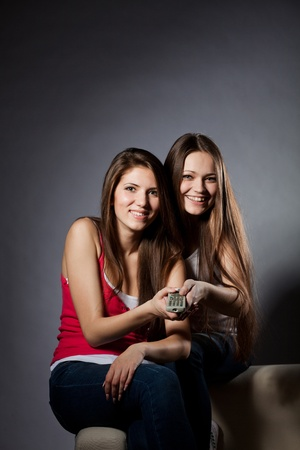 Two girls are watching TV photo