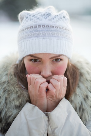 cold woman: girl in nature in winter Stock Photo
