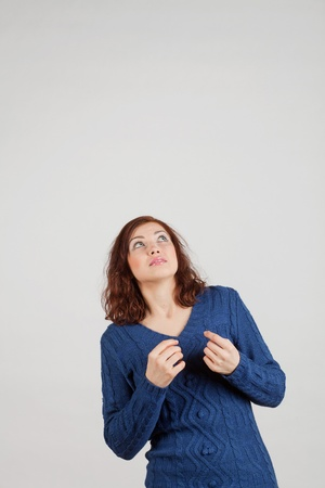 cowering: frightened girl in a blue shirt looking up cowering