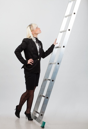 she looks top of the stairs businesswoman photo