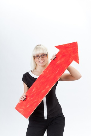 businesswoman with an arrow represents the graph Stock Photo - 12371000