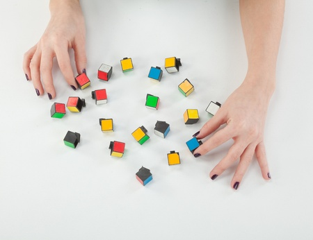 female hands with cubes of the puzzle