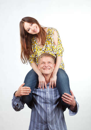 shoulder ride: Happy girl on mans shoulders