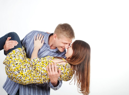 carrying girlfriend: man is a girl in his arms Stock Photo