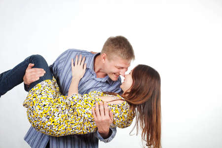 man is a girl in his arms photo