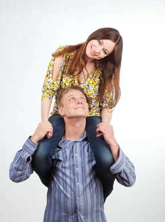 shoulder ride: Happy girl on mans shoulders