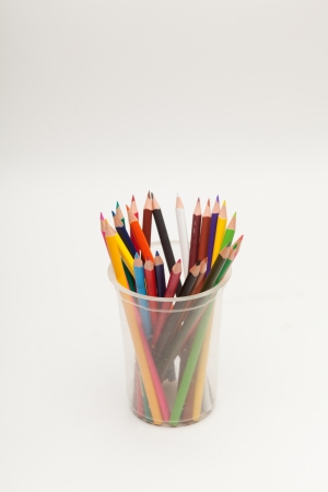 Color pencils in glass isolated on white photo
