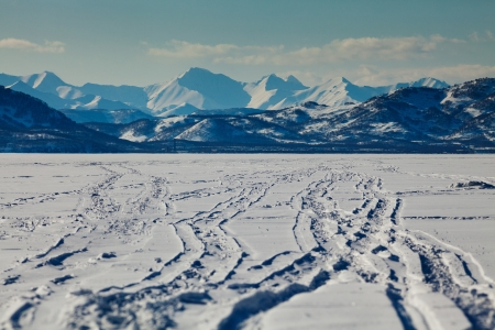 Snowmobile track at frozen bay, Kamchatka photo
