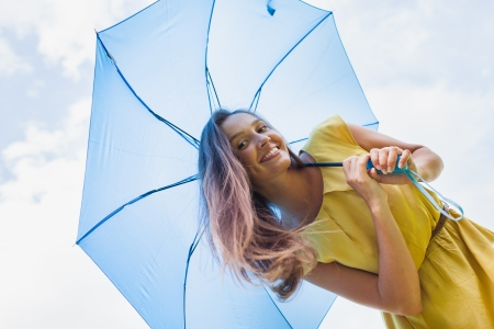young girl with blue umbrella photo
