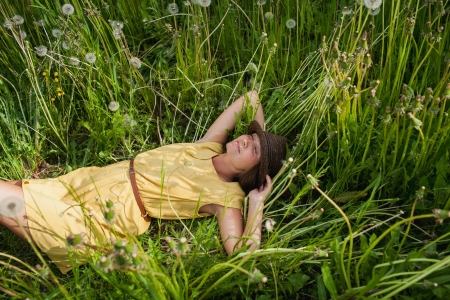 young girl lying in the grass photo