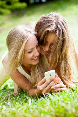 girl in the park with mobile phones photo