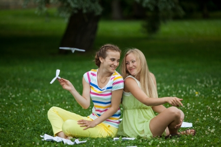 girl in the park on the grass Medes launch paper airplanes photo