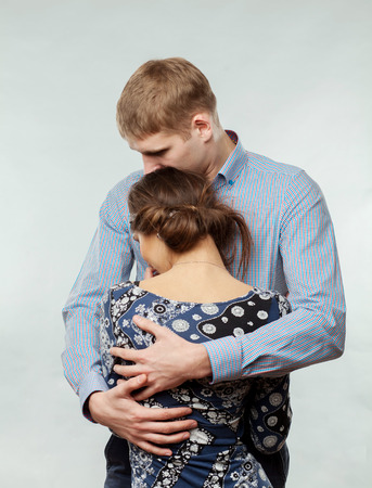 young man comforting a girl