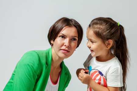 daugther: daughter mother whispers in the ear of his secret