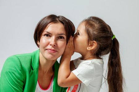 daughter mother whispers in the ear of his secret