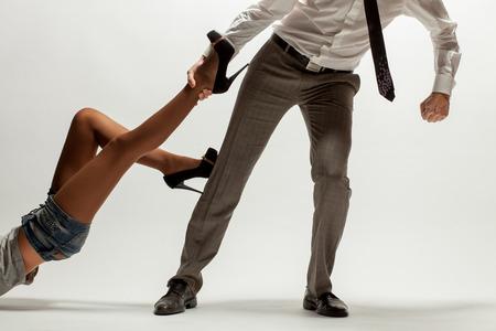 Woman pulls man Stock Photo