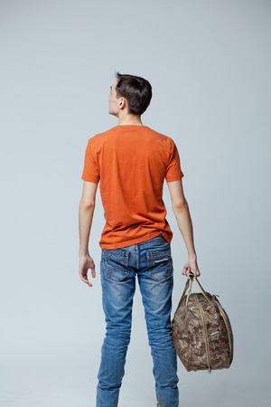 waft: male student with bag, white background in studio
