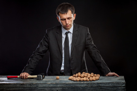 opt: solve the problem of how to crack a walnut Stock Photo