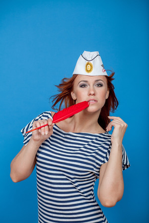 foretaste: sailor girl in a striped vest with a red pen Stock Photo