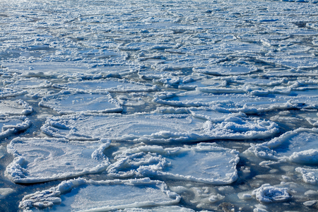 ice floes: broken ice floes in the water from above
