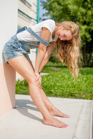 shoeless: she leaned against the wall and resting his knees laughing infectiously