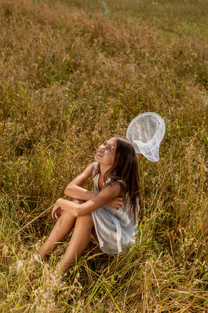 the weariness: girl was tired and to catch butterflies sitting on field