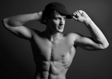 muscled: Muscled model with a cap in b&w