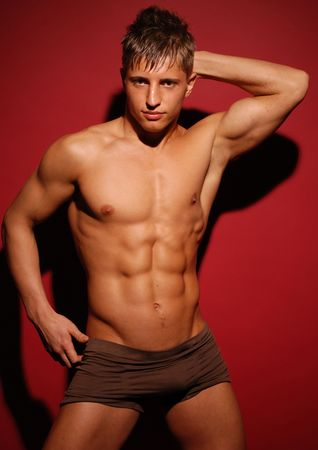 muscled: Muscled model on red background Stock Photo