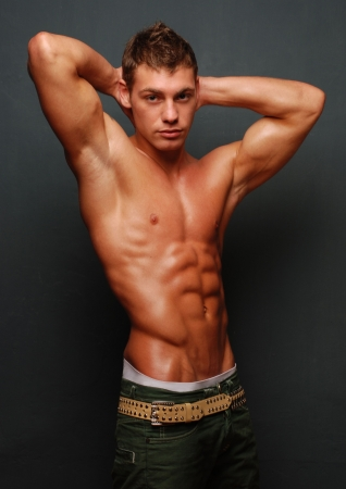 muscular male: Male model posing in studio