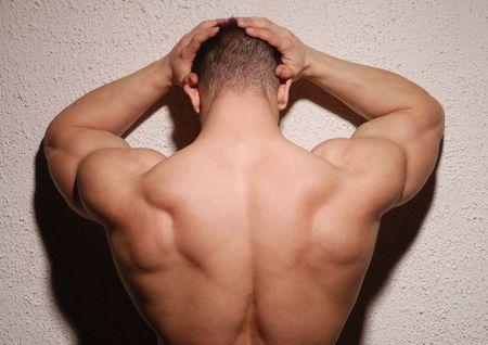 male bodybuilder: Bodybuilder posing in studio showing his back Stock Photo
