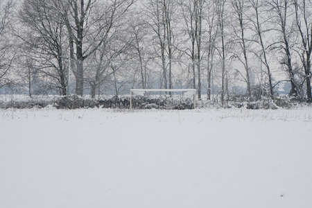 Football field covered with snow Foto de archivo