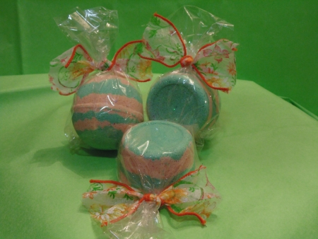 Green and pink  and orange packaged Bath Bombs photo