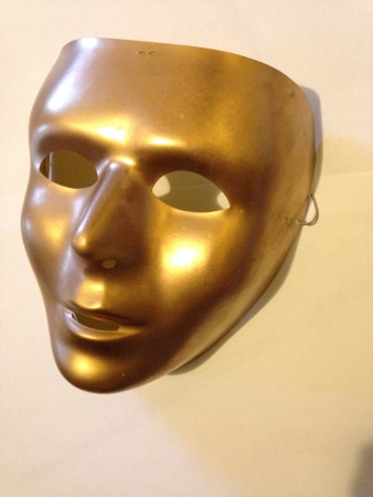 Gold or golden mime mask theater mask