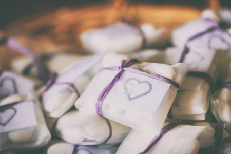 sachet: Preparation for wedding favors: confetti, jute sachet and purple sachet. Stock Photo