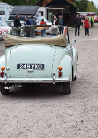 UK, Quorn - May 2015: Vintage morris minor driving into a classic car rally Redakční