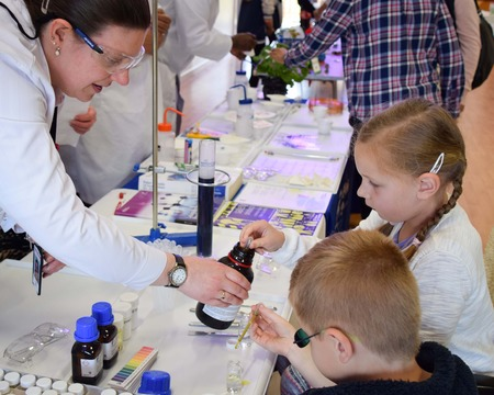 UK,ROTHLEY - 29 OCTOBER 2015: Laboratory chemists tak a day out of the lab to teach children about chemistry as part of the UK STEM, science, technology,engineering and mathematics education program.