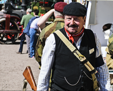 LEICESTERSHIRE,UK  - JUNE 07 2015:  Man dressed in style of French resistance fighter during Victory Day Europe Celebration Event at Great Central Railway, Quorn