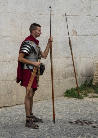 Croatia, Split - June 2018: Re-enactors dressed as Roman Legionnaires, wait to pose with Tourists at the gates to the  Diocletian Palace Editorial