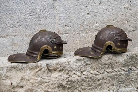 Croatia, Split - June 2018: Replica Roman Legionaries helmets in the Gallic style, used by re-enactors in the Diocletian Place Stock Photo - 119471183