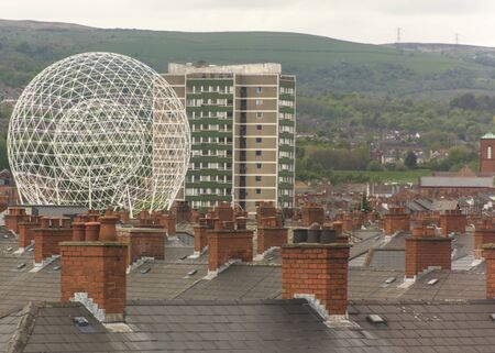 UK, Belfast - May 2015: View of the RISE or 'The Balls on the Falls' across the rooftops of Belfast City Stock fotó