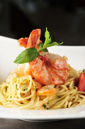 Pasta with prawns   shrimps, Delicious spaghetti with prawns   shrimps and tomatoes  photo