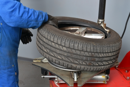 shop skill: Tire change closeup, Mechanic is changing car tire