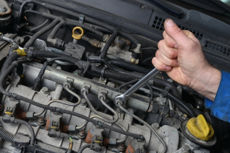 car repair shop: Auto Mechanic is working on engine in car repair shop